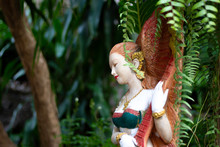 A Fairy Statue Surrounded By A...