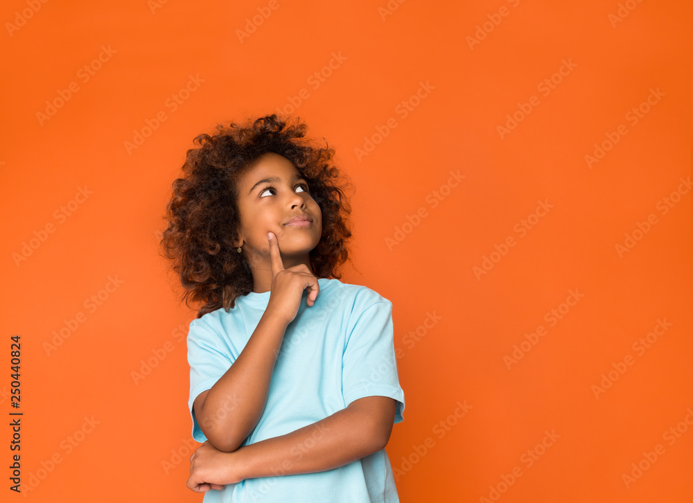 Fototapety, obrazy: Little daydreamer. Girl holding finger on chin and looking away