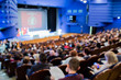 canvas print picture - Defocused image. People in the auditorium. International conference. Flags of different countries on stage.