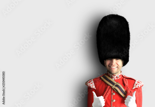 Fototapeta Young man in the costume of the Royal guards of Britain obraz