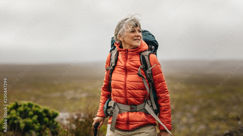 Fototapety, obrazy: Senior woman on a hiking adventure