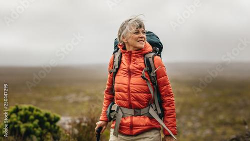 Canvas Print Senior woman on a hiking adventure