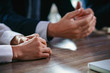 Close up of business people's hands on the table
