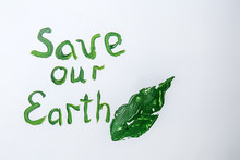 Text SAVE OUR EARTH With Leaf Print On White Background