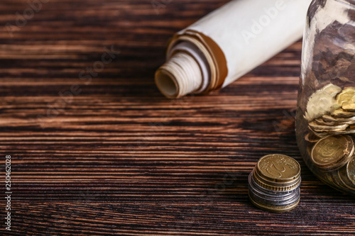 The Scroll of Esther and jar with coins on wooden table Wallpaper Mural