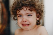 Portrait Of Beautiful Crying K...