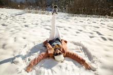 Happy Woman Lying On Snow
