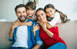 canvas print picture - Young happy family relax together at home smiling and hugging