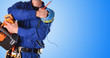 canvas print picture - Electrician with tools and electrical equipment isolated blue detail