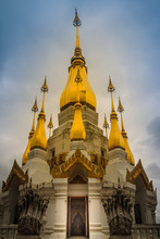 "Beautiful Golden Pagoda With White Clouds And Blue Sky Background Named ""Phra Dhamma Chedi Si Tri Bhumi"" At Wat Tham Khuha Sawan, Khong Chiam, Ubon Ratchathani, Thailand."