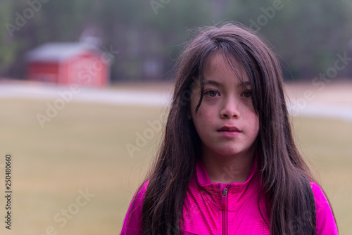 Fotografie, Obraz  Young Asian Girl with pink jacket