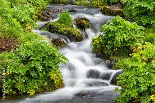 Fényképezés  Closeup of small waterfall cascade by Seljalandsfoss, Iceland with smooth long e
