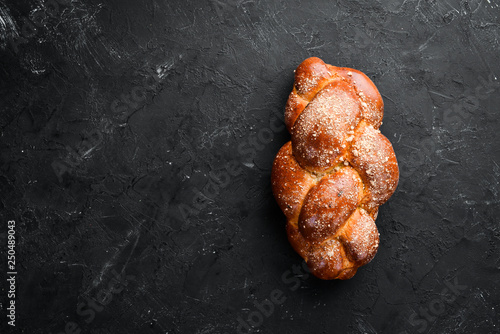 Braided bread with flour. Top view. Free space for your text.