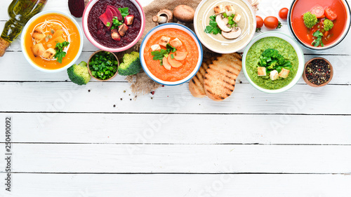 Variety of colorful vegetables cream soups. Concept of healthy eating or vegetarian food. Top view. Free copy space.