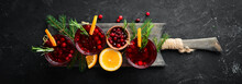 Glasses With Cranberry Juice. Cranberries, Limes, Rosemary. On A Rustic Background. Top View. Free Space For Your Text.