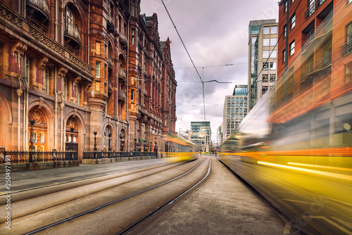 Fényképezés Pair of tram light trails at St Peter's Square, Manchester, England