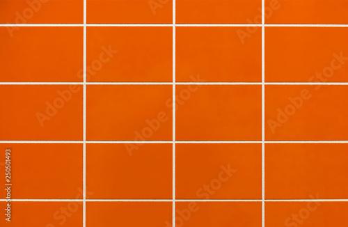 Stampa su Tela Orange ceramic tile on the wall in the bathroom