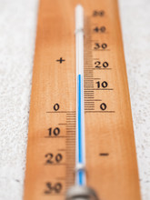 Wooden Thermometer Showing 15 Degrees With Blue Line