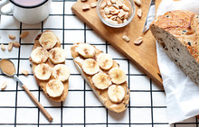 Peanut Toasts With Banana Slices Breakfast Flat Lay With Cup Of Tea. Top View Healthy Food Composition