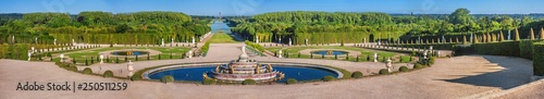 Poster de jardin Paris Panoramic view of the Versailles Park - the Latona Basin with the Grand Canal in the background under the summer sun, Versailles, France