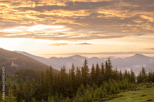 Tuinposter Bergen Beautiful sunlight illuminates the clouds.
