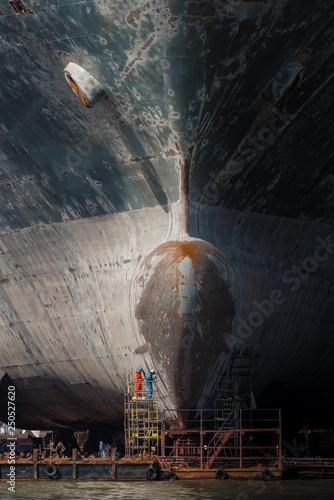 Gdansk shipyard with monumental bow of cargo ship. Fototapet
