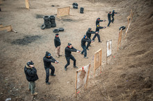 Students Group With Instructors Practice Gun Shooting On Shooting Range
