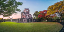 The Atomic Bomb Dome Panorama In Hiroshima And The Surounding Garden In Autumn At Sunset On The Side Of Motoyasu River In Japan, With The Peace Memorial Park On The Left In The Background.
