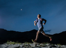 Male Hiker Running On Mountain At Night