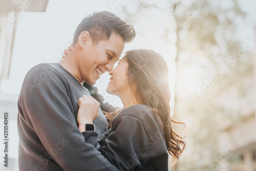 Fotografie, Obraz Asian couple in love embracing outdoor