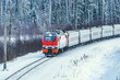 Passenger train approaches to the station at cold winter morning time. Fryazevo. Moscow region. Russia.