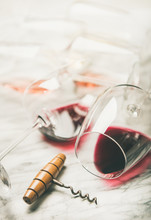 Red And Rose Wine In Glasses And Corkscrew Over Grey Marble Background, Selective Focus . Wine Bar, Winery, Wine Degustation Concept