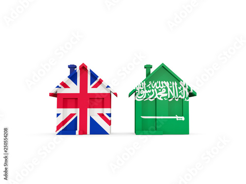 Poster de jardin Oiseaux en cage Two houses with flags of United Kingdom and saudi arabia