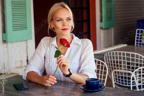 Fotografie, Obraz  lady with rose in restaurant summer cafe