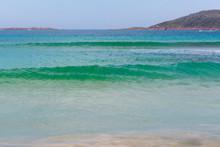 Turquoise Ocean Waves Flowing Towards A Beach In Australia