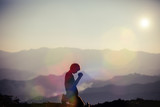 Faith of christian concept: Spiritual prayer hands over sun shine with blurred beautiful sunset background