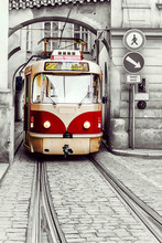 Red Vintage Tram In The Old Streets Of Prague