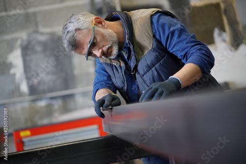 Mature ironworker in workshop Canvas-taulu