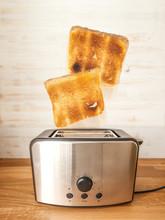 Jumping Toasts. Preparing Brea...