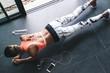 Leinwandbild Motiv Model wearing fashion sports wear doing exercise at black floor