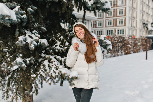 eaf5705feb02 Joy, happiness of amazing beautiful girl smiling in warm winter clothes on  fri tree full