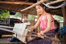Young Women Weaving With Tradi...