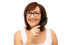 Beauty, Haircare And Old People Concept - Portrait Of Smiling Senior Woman In Glasses Brushing Hair By Hairbrush Over White Background