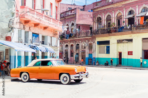 View of yellow classic vintage car in Old Havana, Cuba Canvas Print