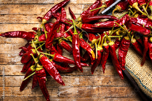 Canvas Prints Hot chili peppers Dried red peppers on a rustic table
