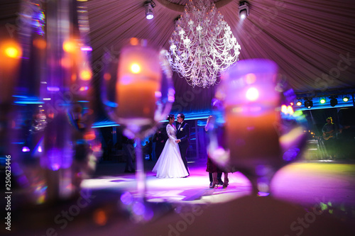 Canvas Print happy gorgeous wedding couple having first dance at wedding party in restaurant