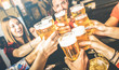 canvas print picture - Friends drinking beer at brewery bar restaurant on weekend - Friendship concept with young people having fun together toasting brew pint on happy hour at pub - Focus on glass - Bright contrast filter