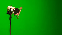 On A Light Background With Smoke (chromakey). Professional Light For The Production Of Cinema, TV Shows In The Green Room