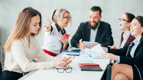 Corporate employees. Bullying and mocking. Business team meeting. Woman point finger at upset colleague checking smartphone.