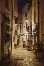 Narrow White Street And Restaurant Tables In Locorotondo, Region Puglia, Italy